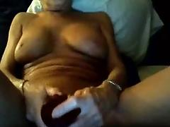 Mature plays with her tits and...
