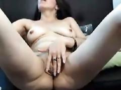 Colombian milf plays with her pussy