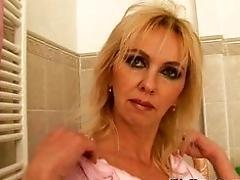 Huge-boobed mature mom fucks...