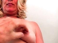 Mature blonde gets finger fucked...
