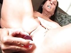 Mature woman masturbating herself