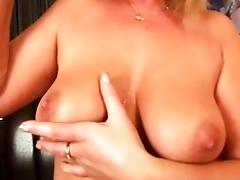 Mature blonde with big tits...