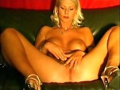 Mature blonde massaging on...