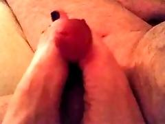 Rubbing his cock with my feet