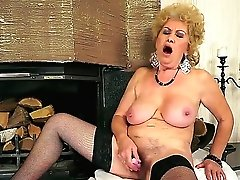 Big-chested grandma Effie shoves...