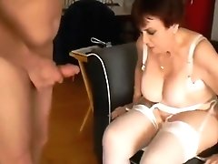 Granny In Stockings Gets Two...