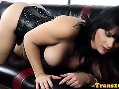 Kinky shemale in corset wanking off