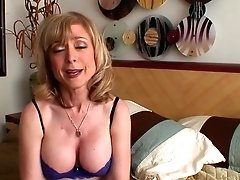 Blonde Nina Hartley Strips Down...