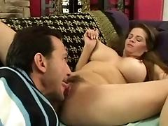 Longhaired busty MILF gets...